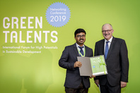 Parliamentary State Secretary Dr Michael Meister and Green Talent Debanjan Das