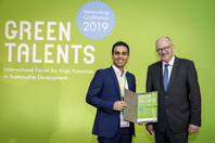 Parliamentary State Secretary Dr Michael Meister and Green Talent Mohammad Ramezani Taghartapeh
