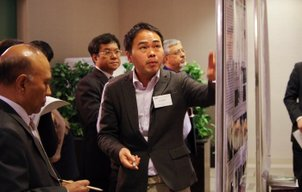 Dr. Joni Jupesta presents his poster at the 18th IGM/SPG Meeting of the Asia Pacific Network in Kobe, Japan.